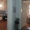 Blick vom Flur ins Arbeitszimmer und ins daneben liegenden Wohnzimmer