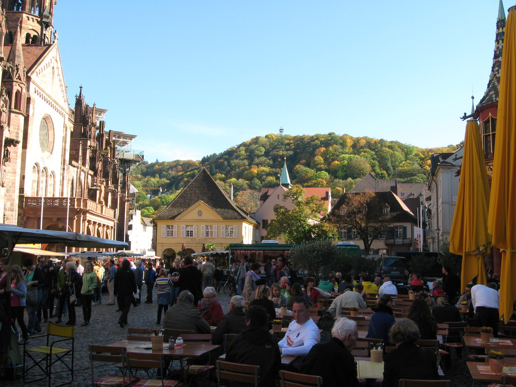 A part of the big daily market beside the old münster. In the background on the hill a viewing tower to climb on.