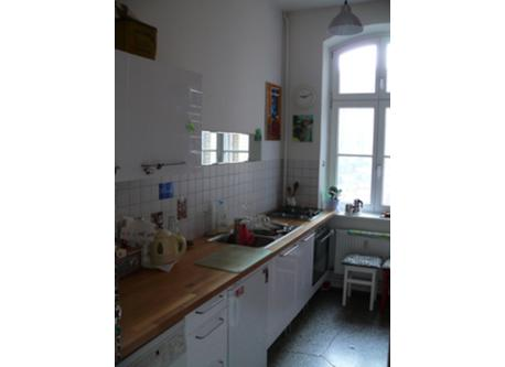 The kitchen with its rear window to our patio. (All necessary kitchen appliances available - apart from a dishwasher.)