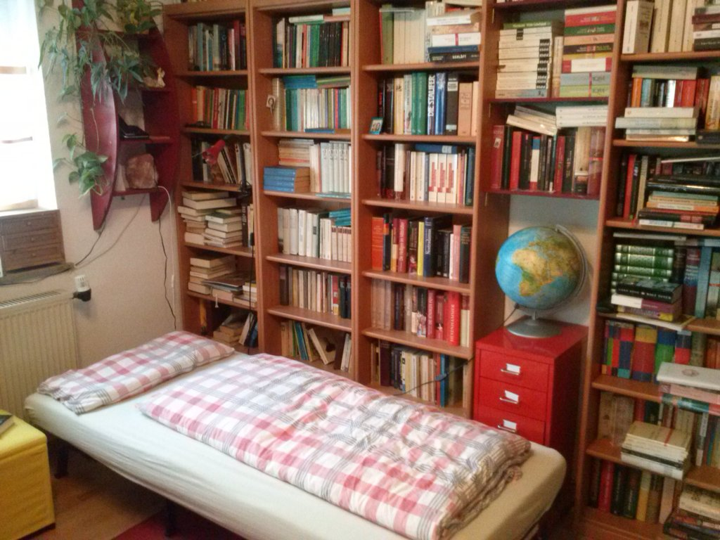 pull-out-arm-chair turned into a single bed in the study