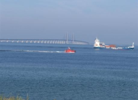 A pilot on the way to guide a ship with the Øresunds bridge in the background