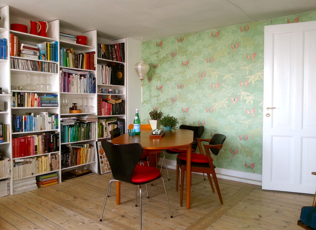 The dinner table and library.