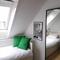 The smaller bedroom has a latex mattress with a memory foam top mattress.