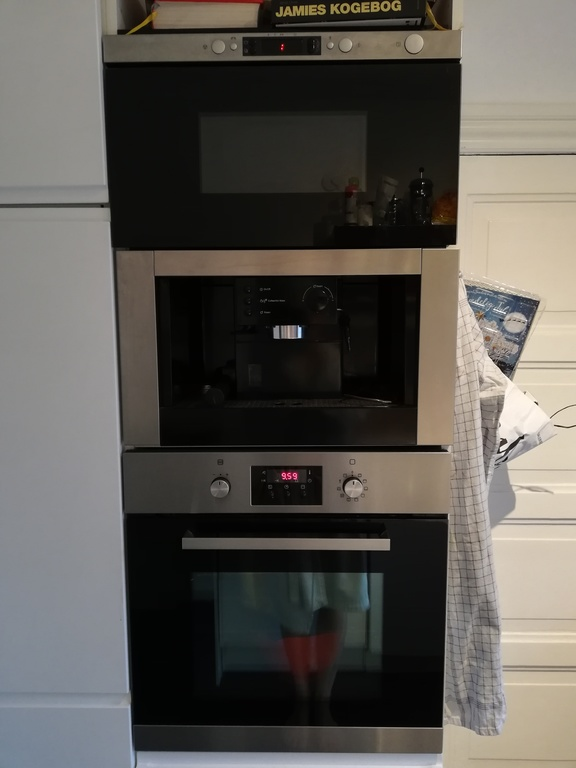 Kitchen with microwave, espresso machine and oven