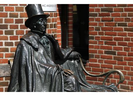 Statue of Hans Christian Andersen on a bench in city centre.