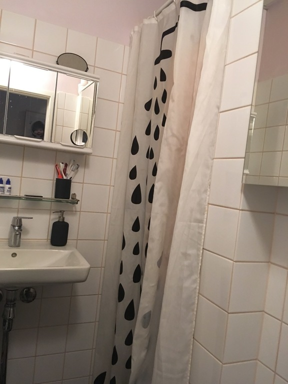 Small newly renovated bathroom with shower
