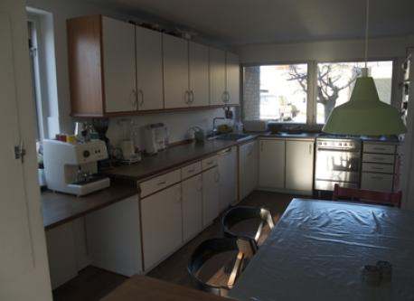 Kitchen with gas stove, dishwasher, microwave and espresso machine