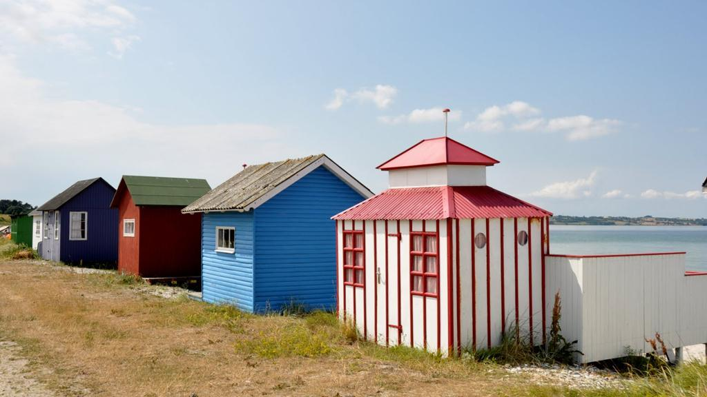Tiny beach houses on the island Ærø - you sail to the island by ferrie.