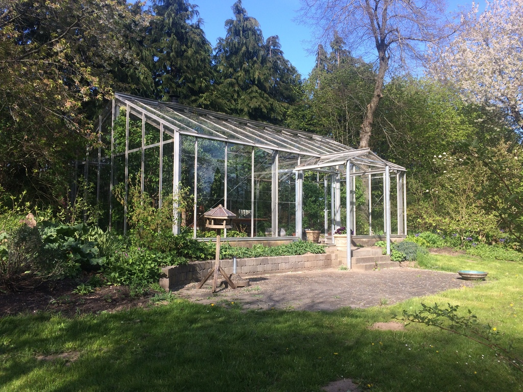 Glass house in the garden
