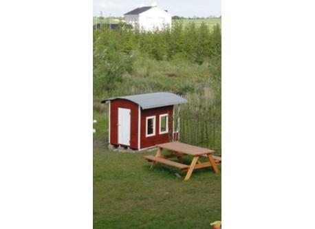 Small playhouse behind the house