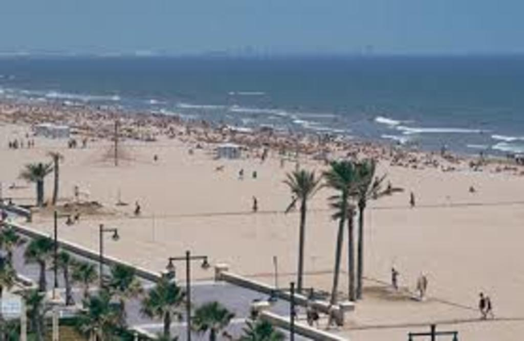 Malvarrosa Beach (25 km from our house).  Long sandy beach with a great boulevard with many restaurants