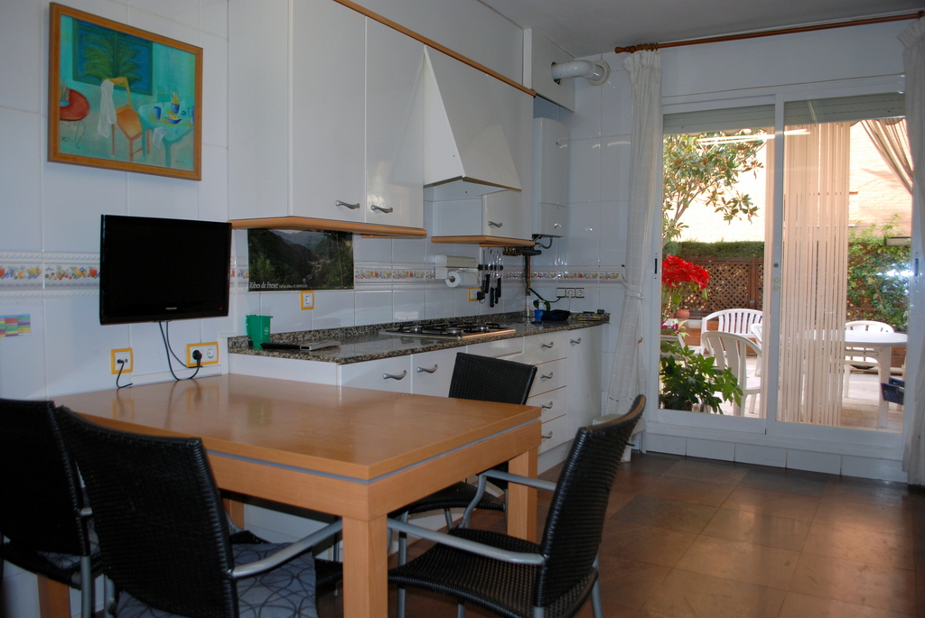 kitchen with access to private garden