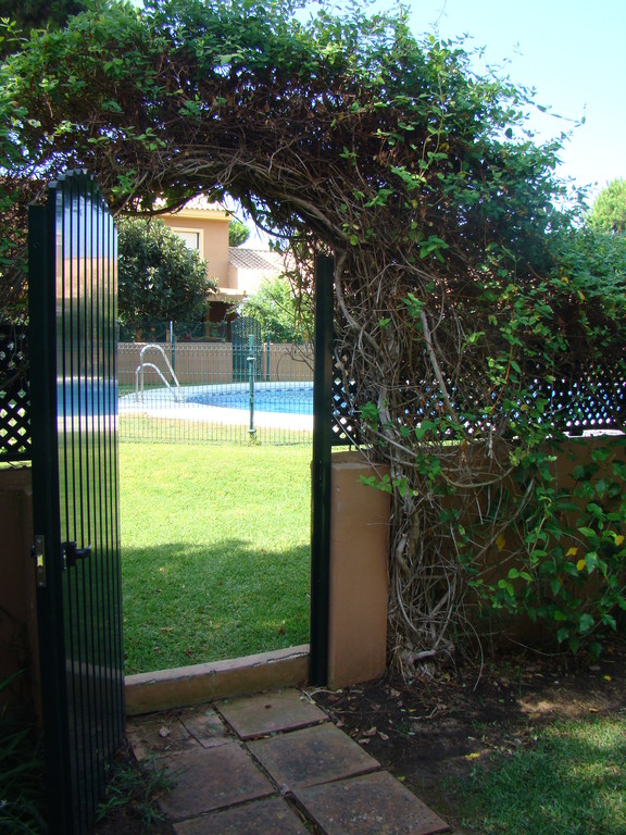 gate connecting private garden to swimming-pool