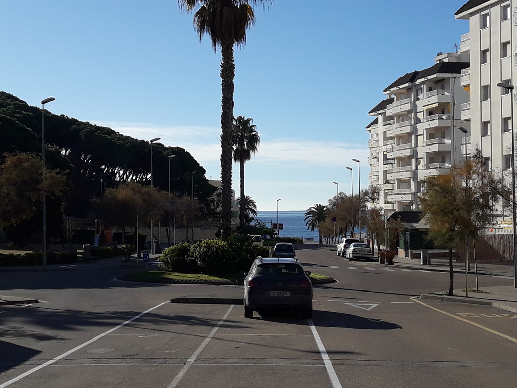 View of the beach from the street in front of the apartment building
