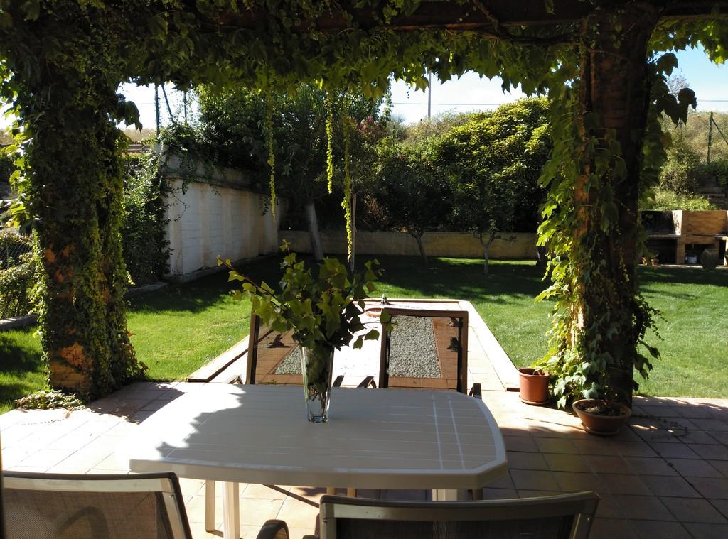 Porche Sur a jardin