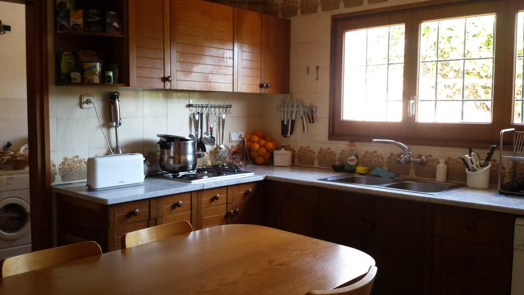 Kitchen with a table for 7 people