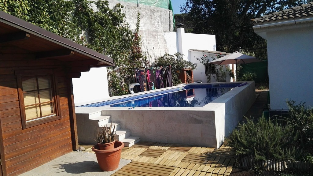 Wooden guest house and swimming pool