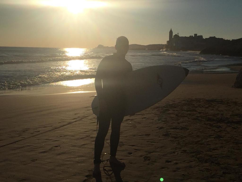 Joel surfing in Sitges