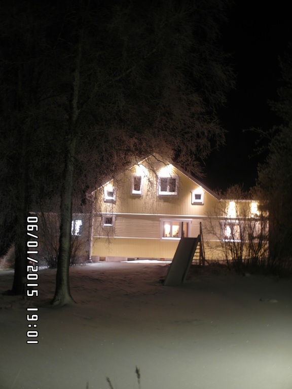 House by night at winter time.