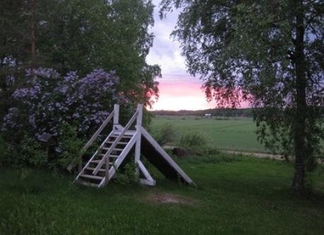 Summer evening. Slide at the front of house.