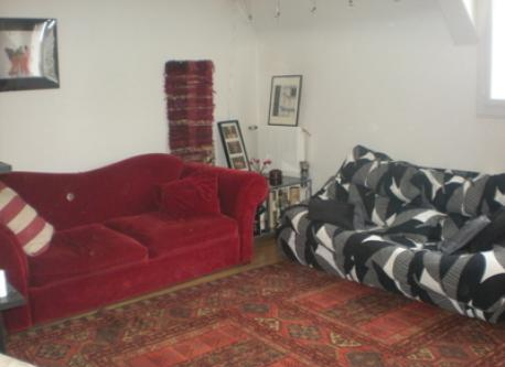 At home, sitting-room  with red sofa-bed