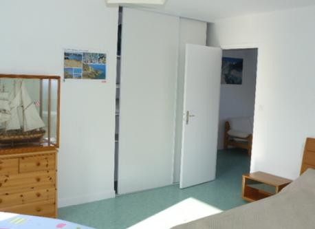 2nd bedroom, with cupboard and small furniture.