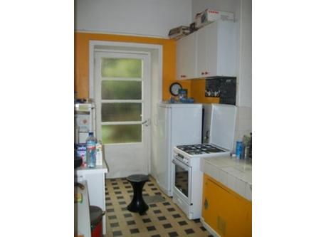 kitchen with microwave oven , electric oven , and gas stove, a fridge and a big freezer
