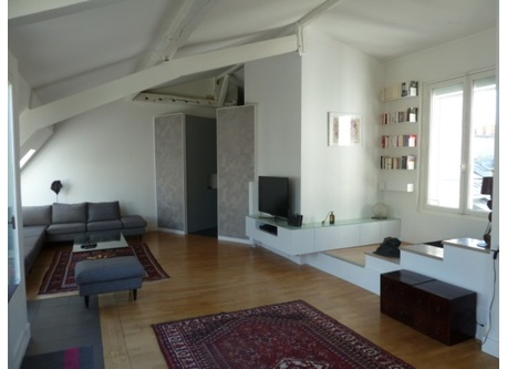 The flat is like a loft under the roof. Here the living room