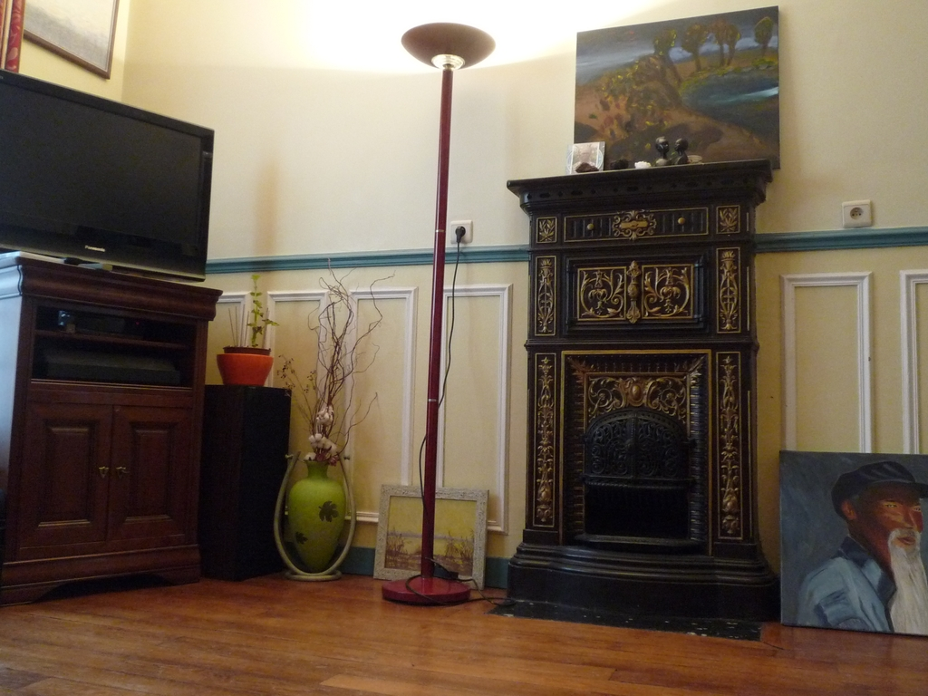 Living Room with a sofa bed and a large dining table, TV set with cable channels,stereo.