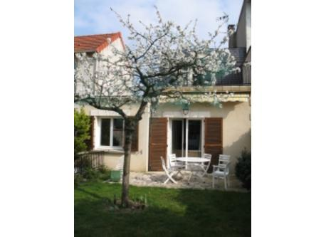 Back of the house with the bloomy cherry tree