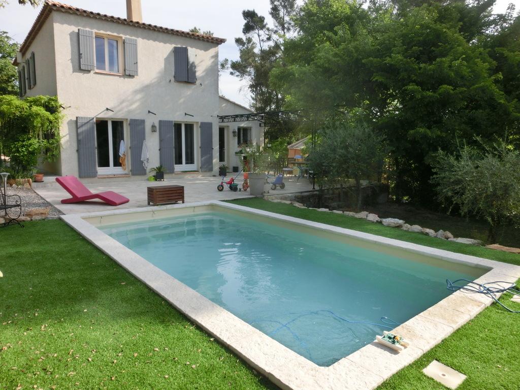 piscine chauffée avec volet  roulant electrique