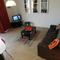 Le salon avec la TV. Wifi partout - The lounge with TV set. Broadband everywhere.