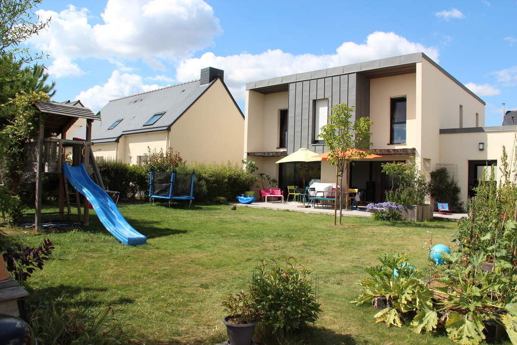 The house seen from the garden, with playgroung, terrace, barbecue