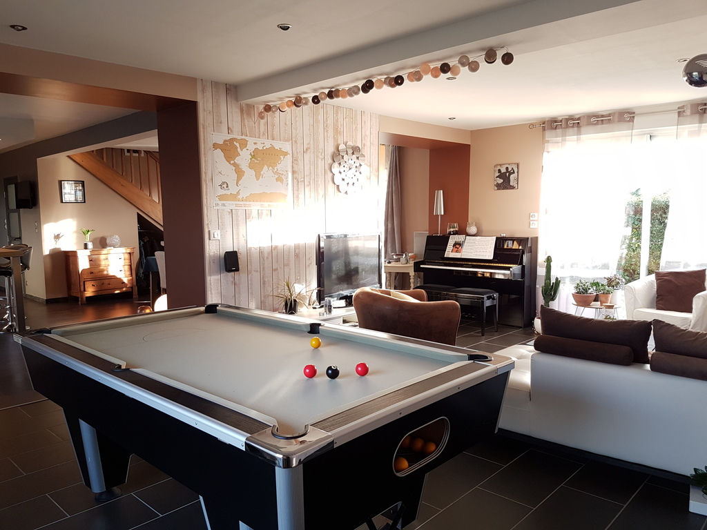 Our living room with billiards and piano