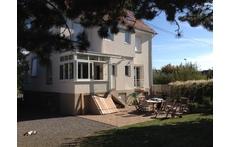 Arrière de la maison : Jardin + Terrasse