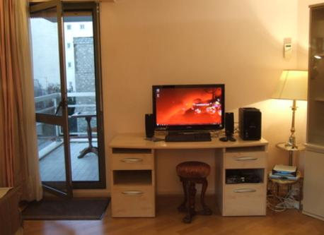 TV and computer ; view of the terrace from the living-room