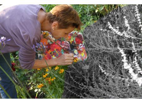 Geneviève painting the garden :)