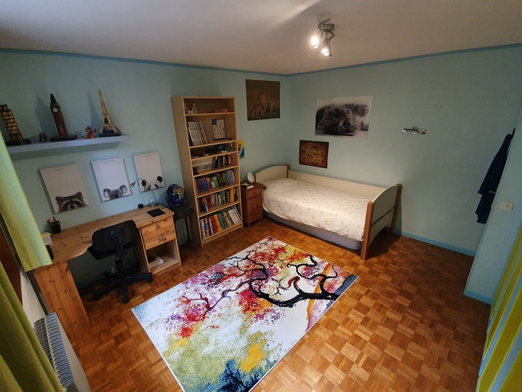 Bedroom with a single bed and an extra mattress