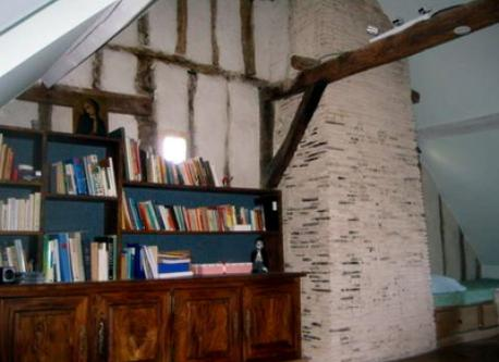 Study high up in attic. One window faces the square below and the other looks onto the garden. This is the smaller of 2 studies.