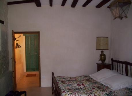 Guest bedroom with queen bed, bathroom and private entrance off the terrace.