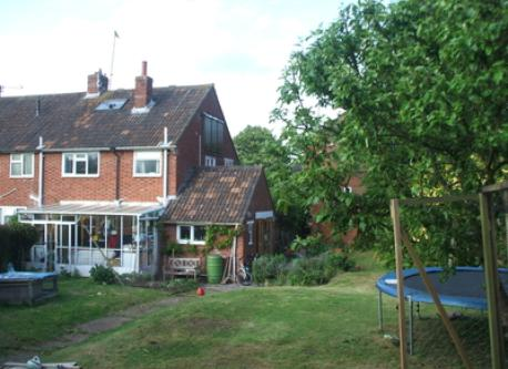 house and garden, with trampoline