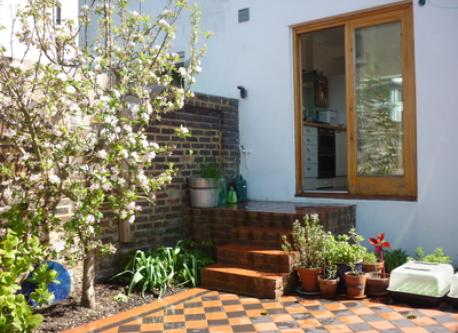 Our back garden, with tiled patio
