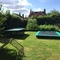 Trampoline and Table Tennis table in garden alongside vegetable patch