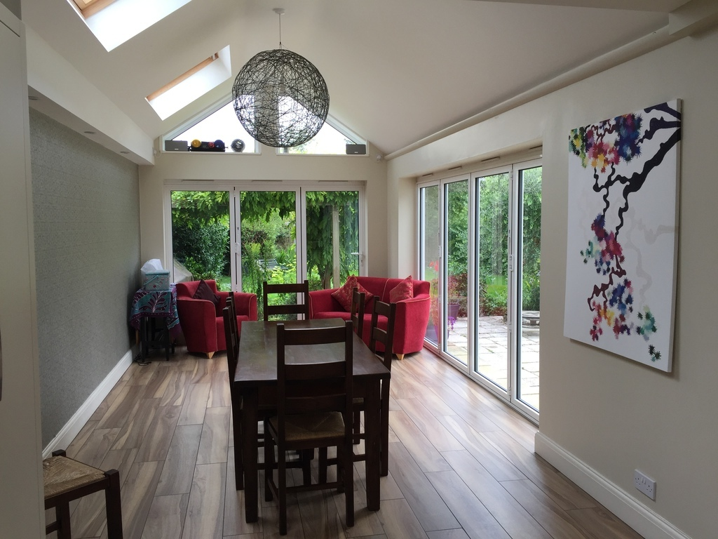 Dining room with sliding glass doors to the patio and garden