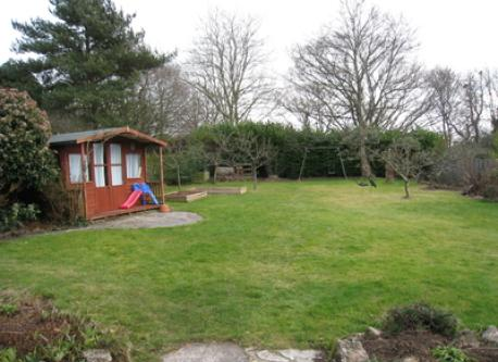 Our garden, with a summer house and now a tree house (not shown!)