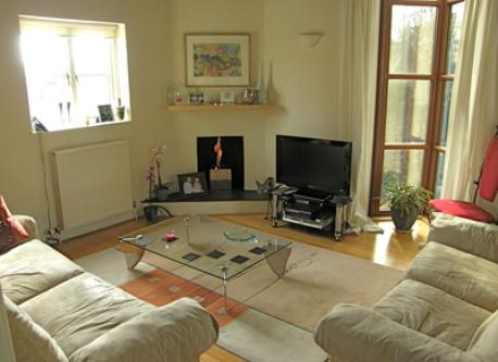 Spacious living room with gas fire.