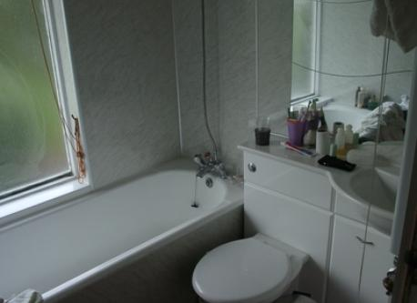 One of 3 bath /shower rooms