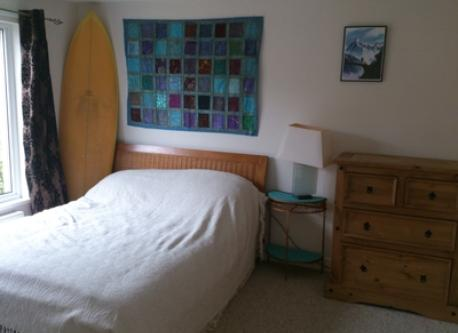 Downstairs Double Bedroom. Many surfboards are available for you to borrow!