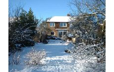 The house from the back garden in winter