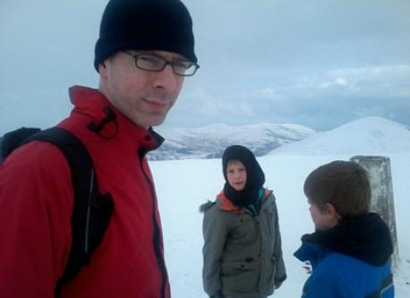 Father and sons in the Pentlands during a winter walk.